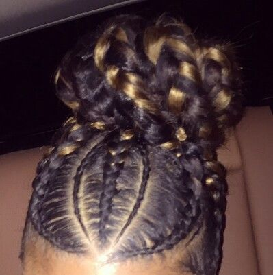 Big and small braids with a mixture of two toned hair in a bun form