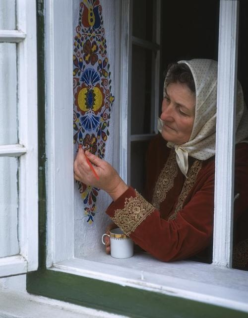 A rural Czech woman decorates her window sill