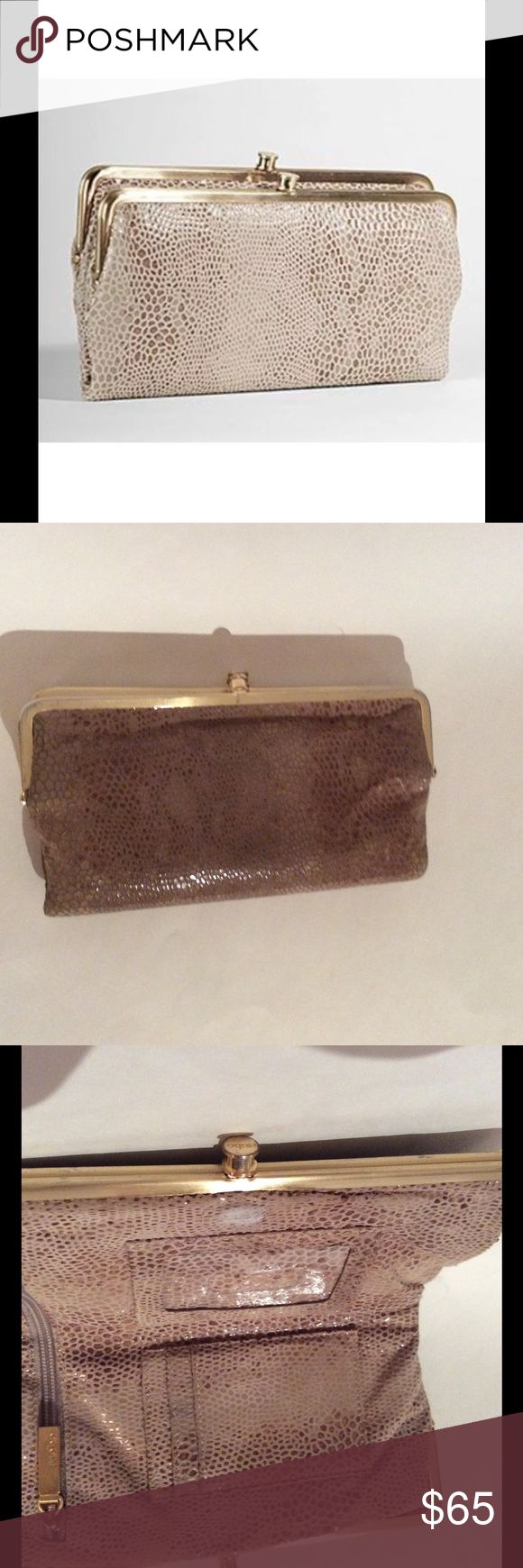 "HOBO Lauren Wallet Clutch Honey Gold Snake Python THE LEGENDARY LAUREN- FUNCTIONAL WALLET BY DAY AND STYLISH CLUTCH BY NIGHT. SHE IS KNOWN FOR HER CARRY-ALL ATTITUDE AND TOTAL COOL FACTOR.  Ext Pocket Type: None Int Pocket Type: Zipper Pocket Closure: Frame Closure Bottom Width: 8.5""W Size: 8.5""W X 5""H X 1""D Strap Drop: No Strap  Gently loved. Wear on gold hardware and snakeskin, as pictured. HOBO Bags Wallets"