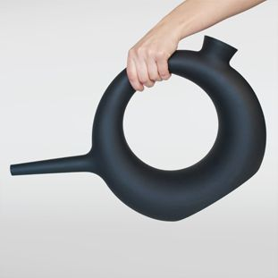 Plastic watering can in rotational molding-don't get the use-it only holds a tiny bit of water....