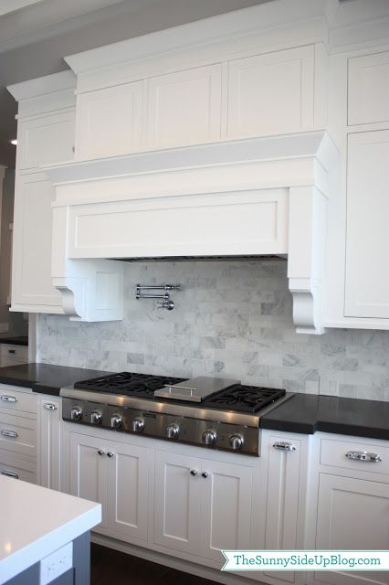 kitchen white cabinets black countertop carrera marble backsplash