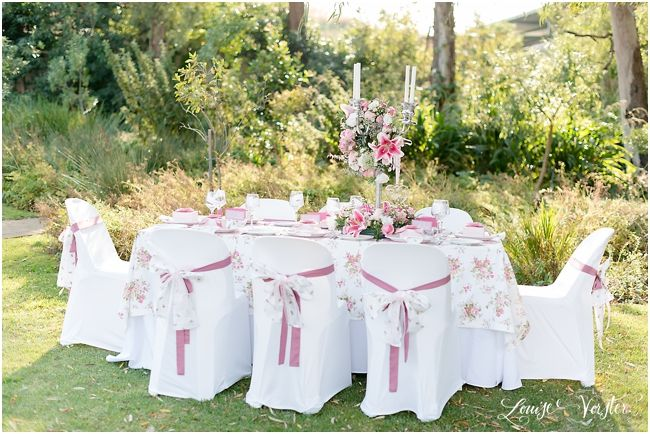 A complete view of pink table and chairs.