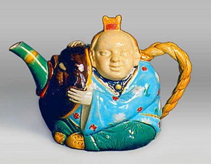 antique majolica - Chinese actor majolica teapot - via atticmag