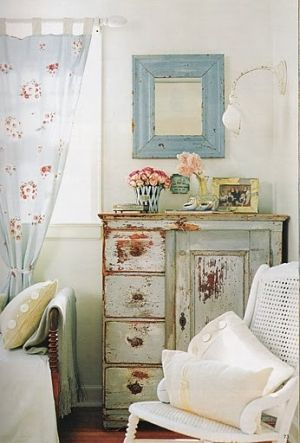 Shabby Chippy...distressed pastel green chest, pale blue mirror, white chair & pillows.