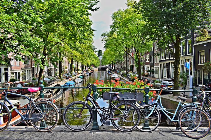 Amsterdam canal, bike friendly city. Beauitful boats and houses