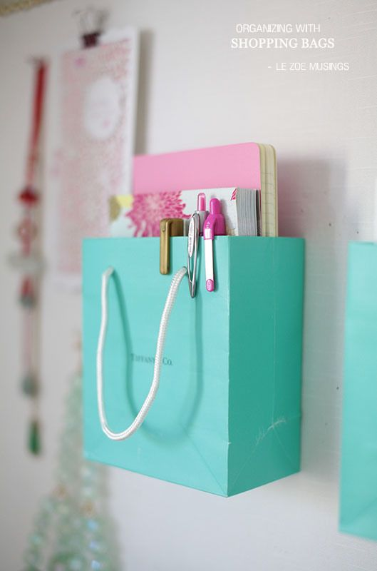 Organizing w/ Tiffany. Hoard shopping bags? Use them to organize your life. Super stylish and useful.