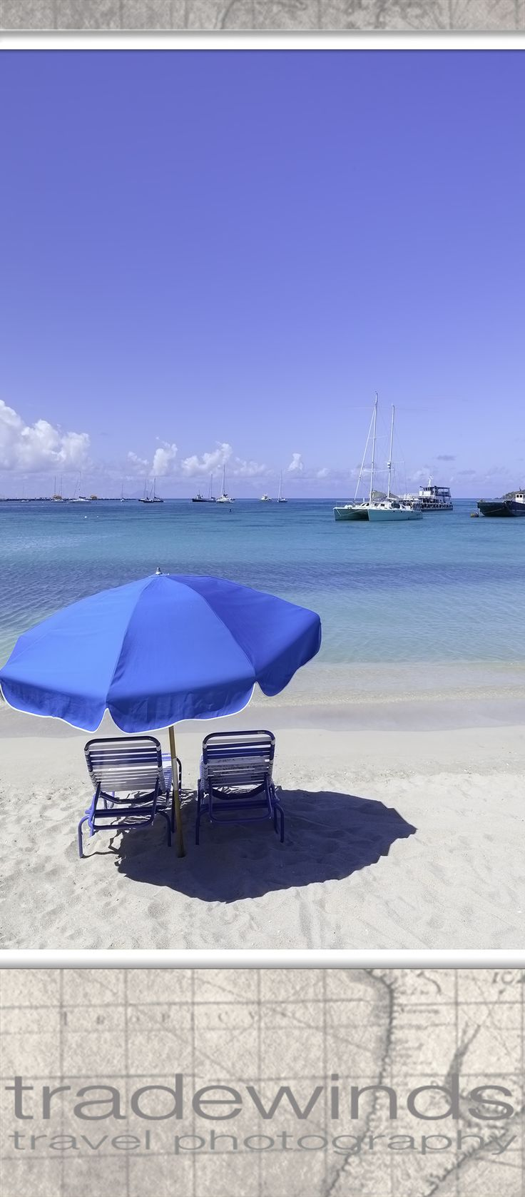 Blue parasol and chairs on St. Maarten beach.