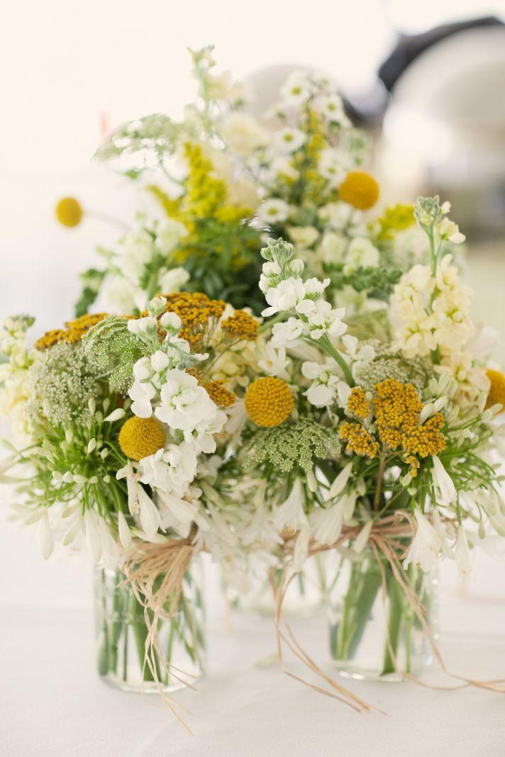 White and yellow flowers, mason jars, and raffia