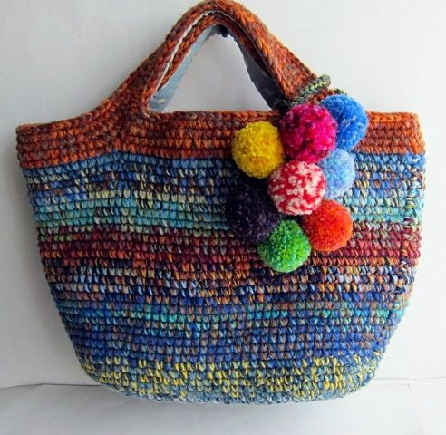 Wool woven crocheted bag with pom pom charms