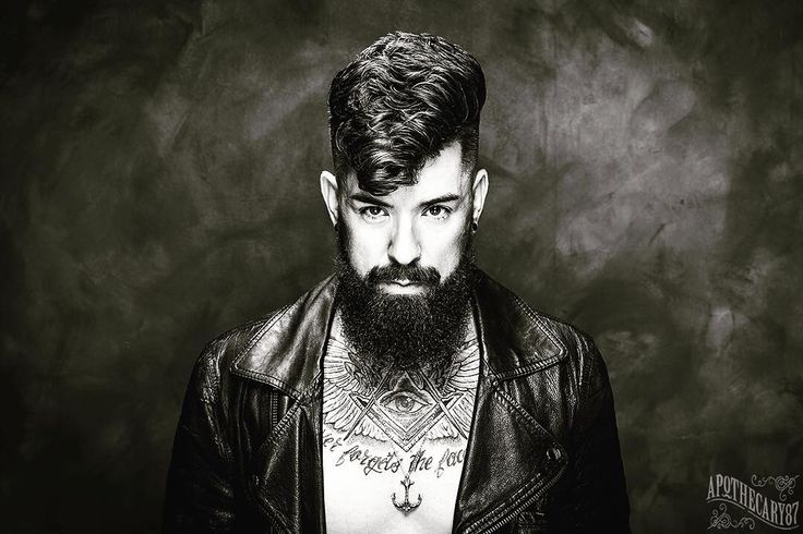 Out of the darkness come the light.  Hair & beard products from @apothecary87  Pendant by @volstead_uk  Photography by @liamoakesphoto  Hair & beard cut & styled by @r.braid from @braidbarbers  #TheManClub #teddyboy #leather #jewlery #grooming #mensgrooming #beard #beardproducts #hair #menshair #tattoo #ink #beardporn #bearded #beardedvillains #model by rossoliversmith