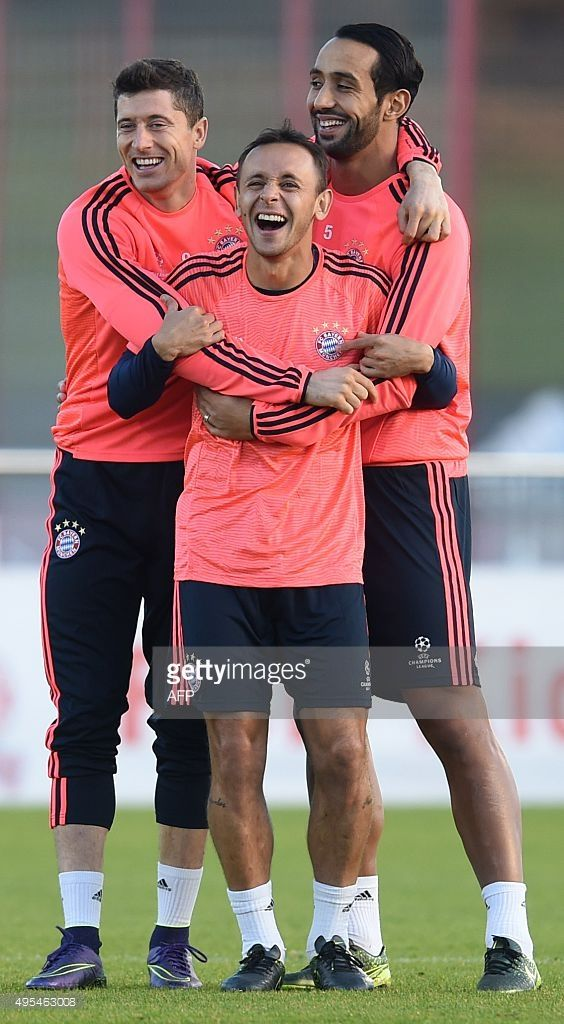 Bayern Munich's Moroccan striker Medhi Benatia, Bayern Munich's Brazilian defender Rafinha and Bayern Munich's Polish striker Robert Lewandowski mess around during the training session on the eve of the UEFA Champions League Group F second-leg football match between Bayern Munich and Arsenal FC in Munich, southern Germany, on November 3, 2015. AFP PHOTO / CHRISTOF STACHE