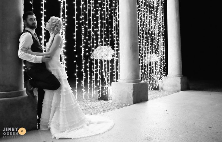 bride and groom in the evening with fairy lights