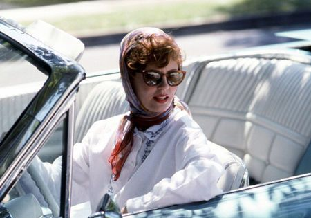 Thelma & Louise. In the 1991 film Thelma & Louise, Susan Sarandon and Geena Davis showed us how road-tripping chic is done right and, naturally, sunglasses were mandatory. Both actresses sported shades throughout the film but we particularly love these cat-eye glasses teamed with a do-saving scarf. Photo by Getty Dec 13, 2012
