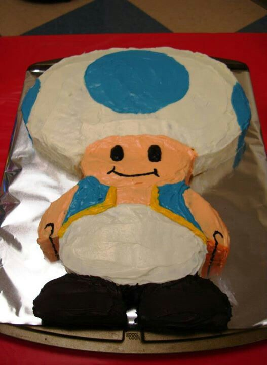 Blue toad birthday cake! Cut and shaped from 1 round and 1 large sheet cakes.