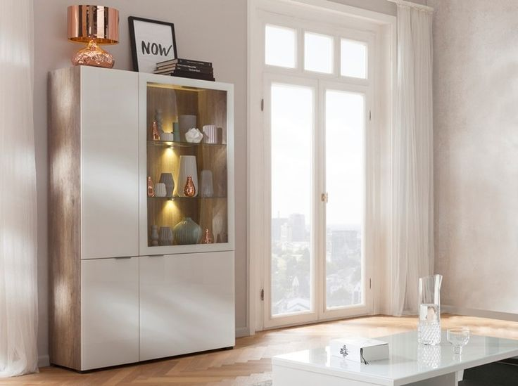 Cleo Cabinet (Wildoak & White glass) - This exquisite wild oak and white glass standing cabinet from Cleo spells German class!  Is stylish enough to be called a collectible. It has great storage with three shutters.  Can be used as  a dining unit! Versatile in use with ample storage, this unit has both definitive style and utility .