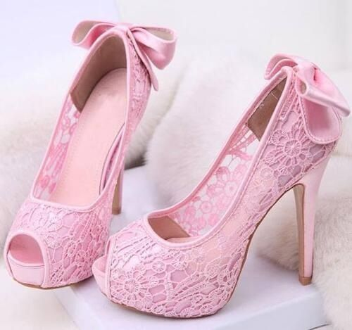 The perfect feminine pretty lace and bow shoe. They don't seem too high, so I would wear them with skirts, dresses, jeans, leggings, slacks, and gowns. That about covers, that they can be worn with  everything.  Elegant !!!