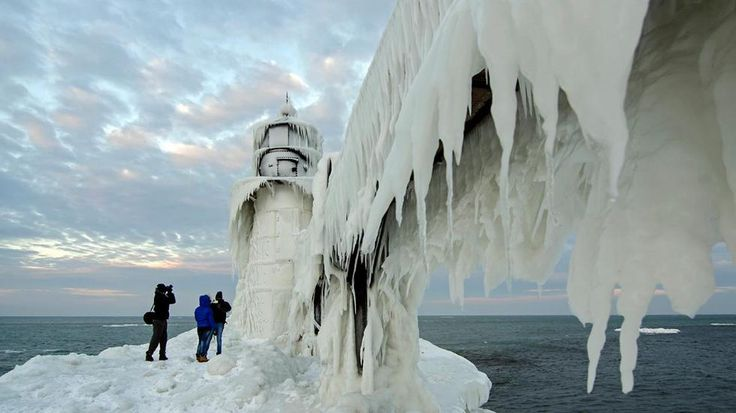 Lighthouses on Lake Michigan On Lake Michigan, many lighthouses get so covered in snow and ice that they look like they're completely made of ice. Already beautiful to photograph, these lighthouses -- which can be covered in feet-thick ice -- look like something out of a Tim Burton film.