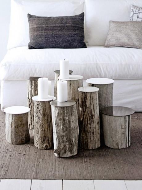 ART ECO. simple collection of tree slices creates an interesting occasional table