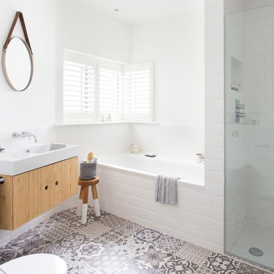 Adding statement floor tiles to a bathroom will immediately add interest and liven up an otherwise clinical-looking space