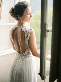 Dreamy beaded open back wedding dress: http://www.stylemepretty.com/2016/02/01/al-fresco-lake-como-wedding/   Photography: The Cab Look Foto Lab - http://www.thecablookfotolab.com/