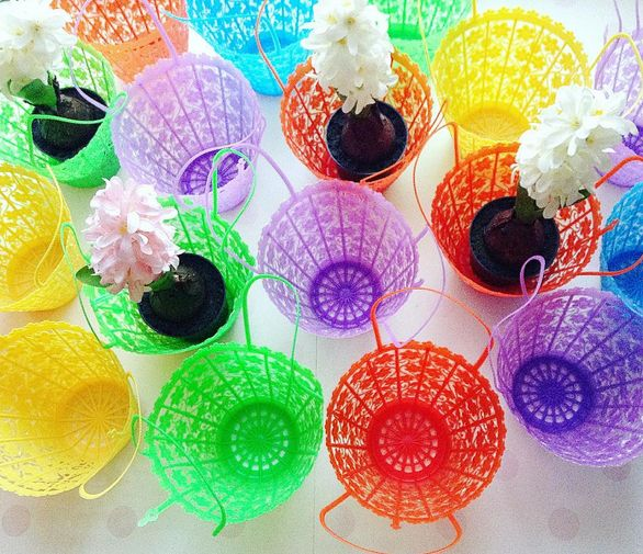 little platic baskets which also make lovely kitsch flowerpots.......