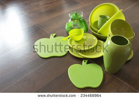 green porcelain dishes on a dark wooden parquet - stock photo