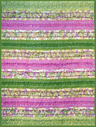 Serger Ruffle Quilt - For this serger quilt we used 4 different fabrics and cut 2 of each color for the front. You could make it as large as you want by adding more strips and have fun with the color.   At the Cotton Shop in Pink, Black, White.