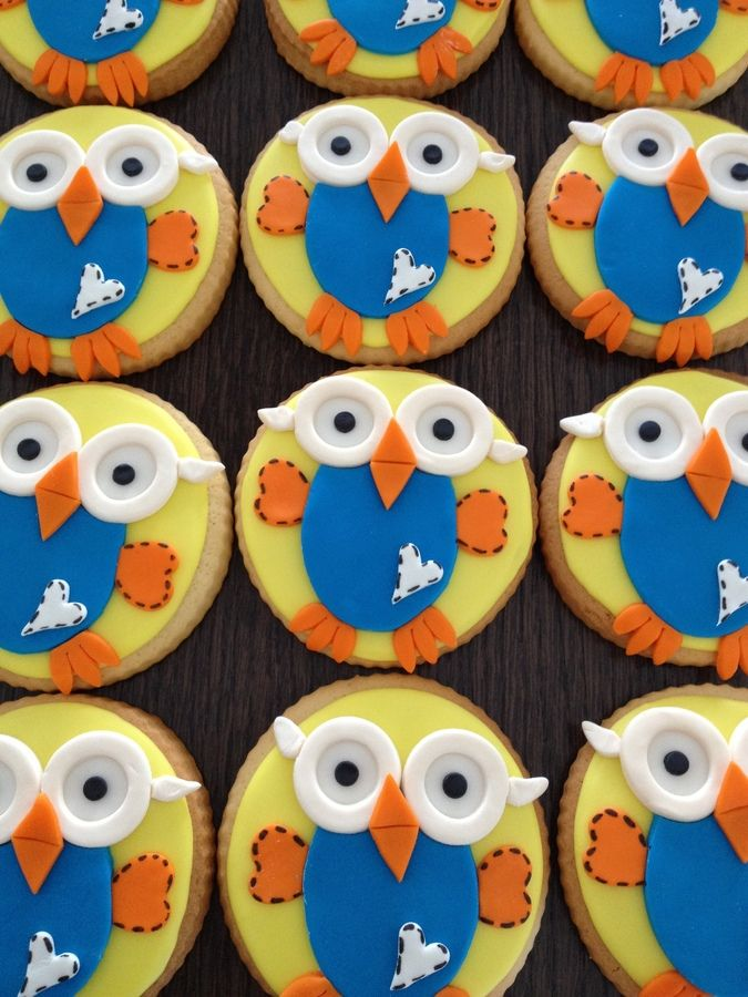 Cookies covered in glaze and Hoot is made from Satin Ice fondant.