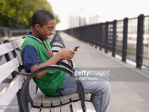 http://cache4.asset-cache.net/gc/84231823-african-teenager-text-messaging-on-cell-phone-gettyimages.jpg?v=1&c=IWSAsset&k=2&d=ryDI1d7uH6CrzNlQ1NQs1Cj%2Be8sWgUo4%2BelrW4uGDRLE6L1X32QzIIJiA%2BG11Q98