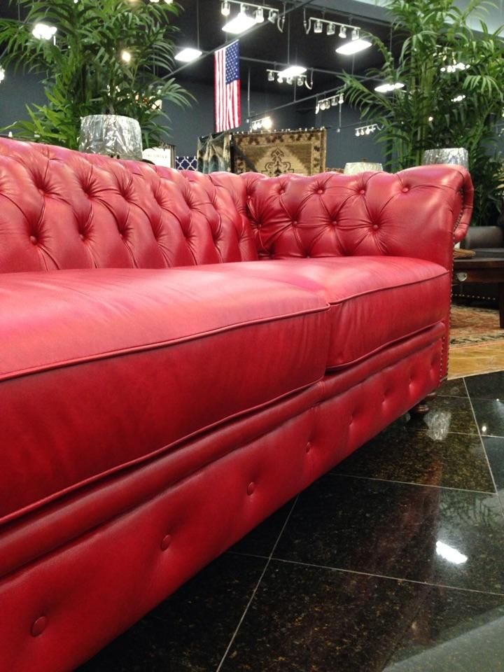 Our gorgeous red leather chesterfield sofa is made right here in America with durability, style and function in mind! Large tufts in the seat back and armrests provide this piece with an element of grandeur, while its vibrant red color brings the sofa to life! | Houston TX | Gallery Furniture |