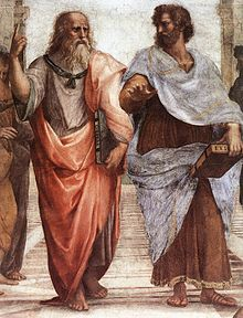 Plato (left) and Aristotle (right), a detail of 'The School of Athens' a fresco by Raphael. Aristotle gestures to the earth, representing his belief in knowledge through empirical observation and experience, while holding a  copy of his ' Nicomachean Ethics' in his hand, while Plato gestures to the heavens, representing his belief in 'The Forms'.