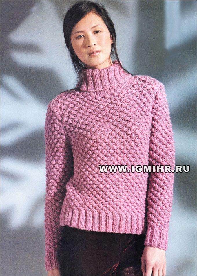 El suéter de color rosa caliente con el modelo tridimensional de los mandos, por diseñadores británicos.  Radios