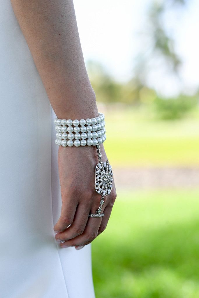 Detail on bride's bracelet made of white pearls