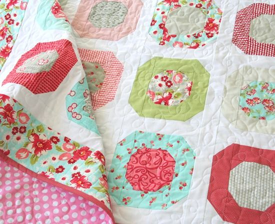 I quilted this with an all-over loopy pattern, and did the borders in a wavy back and forth pattern…not like you can see it but hey…it's there.   This one was made with a Ruby layer cake (here, here, here, here, here, or here…so basically almost everywhere) and pattern (here, here or here…in hard copy or PDF).
