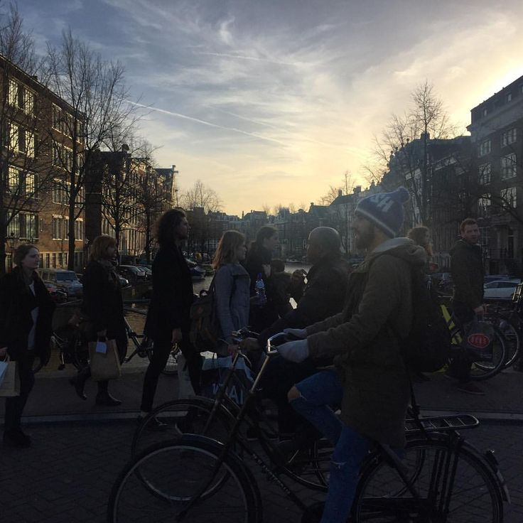 I enjoy every moment as I enjoy every picture. — People walking around.  #city #amsterdamlife...