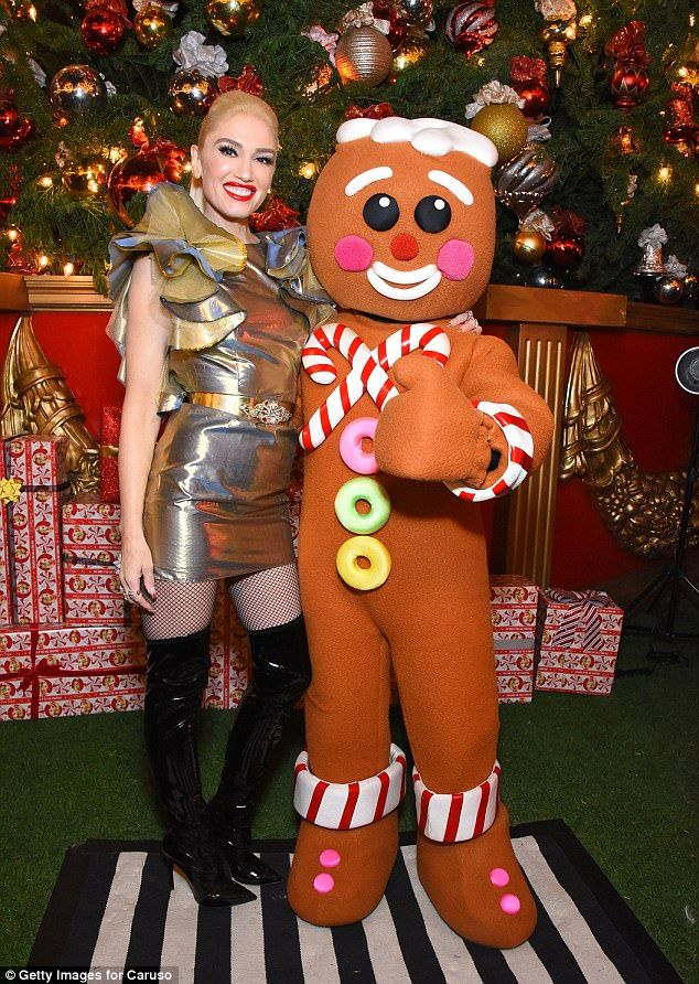 Overjoyed: Gwen Stefani, 48, dazzled next to a gingerbread man as she appeared at The Grov...