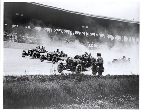 Cars race through the first turn at the 1911 inaugural #Indy500 race