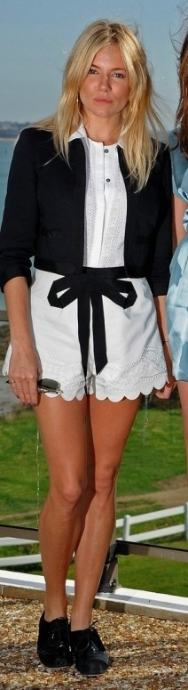 Who made Sienna Miller's black lace shoes, white romper, and black jacket that she wore at the the 21st Dinard British Film Festival on October 9, 2010?