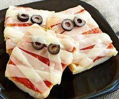 Make MUMMY pizza squares with mozzarella strips & olives
