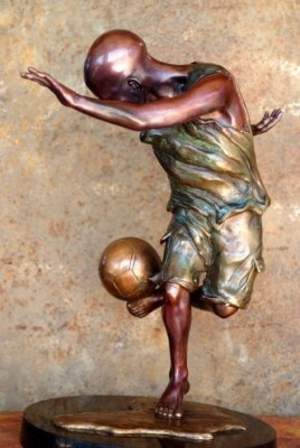 #Bronze #sculpture by #sculptor Michael J Mawdsley titled: 'Aspirations (Bronze African Boy Playing Football statue sculpture)'. #MichaelJMawdsley