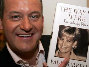 Paul Burrell with a copy of his book about Diana