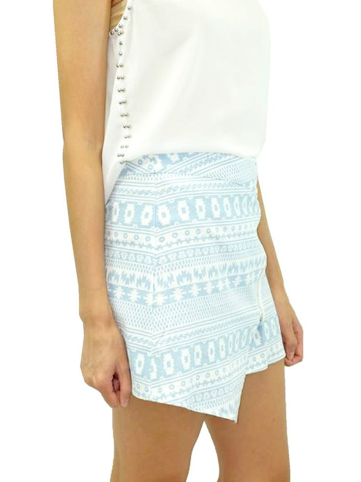 """Infuse your summer style with this casually chic southwestern print asymmetrical skirt. Its geometric appeal keeps things interesting throughout your summer travels and spontaneous warm-weather outings. Pair it with white, contrasting blue, light brown, or coral on top, and add simple sandals or white tennis shoes to keep it fresh.   67% Cotton, 30% Polyester, 3% Spandex Unlined; Runs small Machine wash Imported Style #J50159A Length: 13"""" from waist. Measurements taken from a size Small..."""