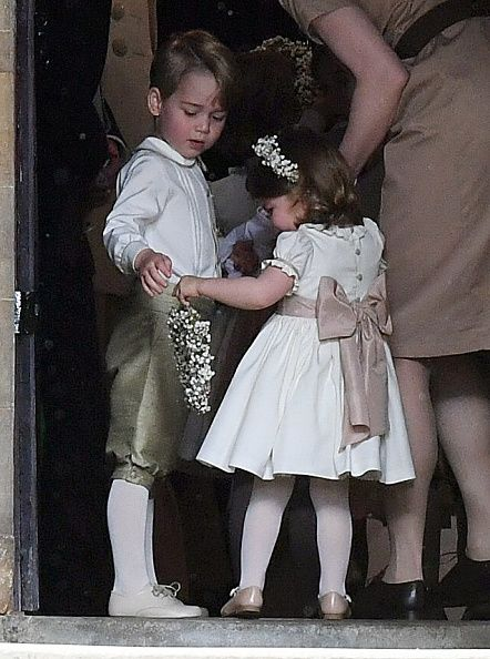Prince George of Cambridge, paige boy and Princess Charlotte of Cambridge, bridesmaid attend the wedding of Pippa Middleton and James Matthews at St Mark's Church on May 20, 2017 in Englefield Green, England.