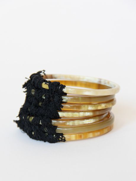 KORA, OCEANIA BRACELET: reclaimed cow horn bangles attached by netting. only one left in @PourPorter's shop. ~~~ Gorgeous!