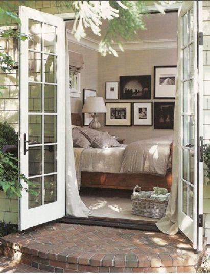 doors in a bedroom that open up into a garden...