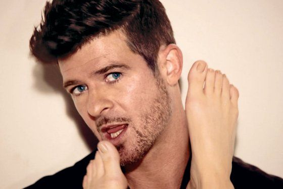 """Not my norm but hes sexy (""""Robin Thicke """")<3 toe sucker? lol kinky"""