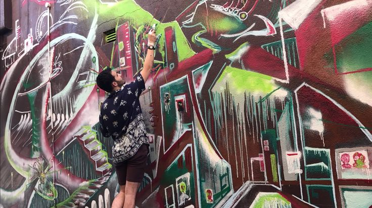 Touching up on a mural in Petersham Sydney.