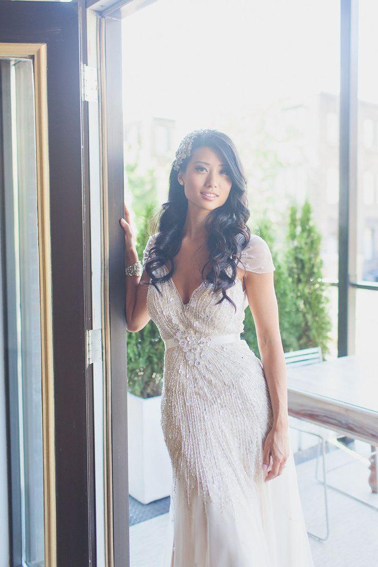 Beaded beauty for beach wedding + cap sleeves + sheer back w keyhole + fit and flare | Style Me Pretty | Dress: Jenny Packham | Photo: Lavish & Light