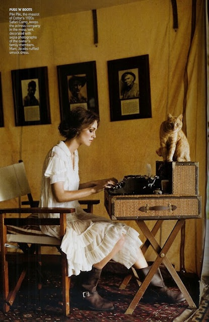 white cotton dress, boots, typewriter & an orange kitty