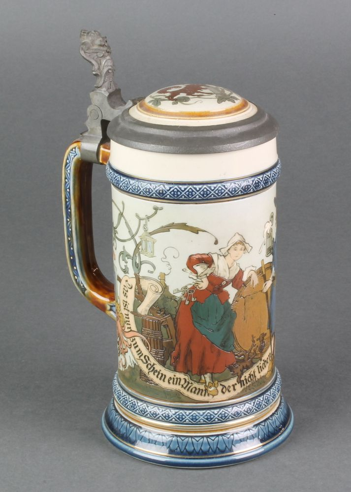 """Lot 93, A Mettlach tankard, the body decorated with revellers, having pewter mounts, stamped 2230 8"""", est £30-50"""